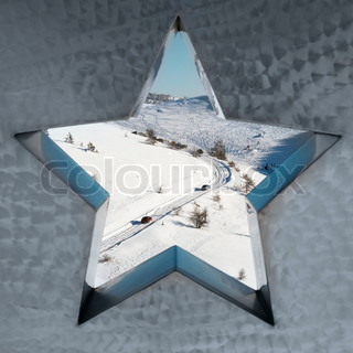 Snow-covered mountains through the star.