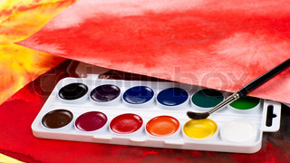 Water color paints, paintbrush and abstract drawings