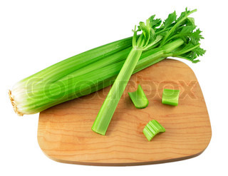fresh celery on a cutting board