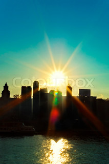 City landscape with silhouettes of buildings at sunset