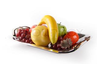 Selection of artificial fruit on plate