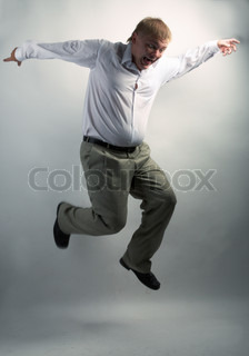 businessman dancing on the grey background
