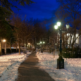 City night scene with lights and snow