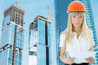 business woman architect on modern buildings background