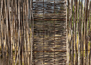 woven wooden fence of twigs of hardwood