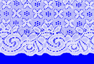 white lace with a floral pattern on a blue background
