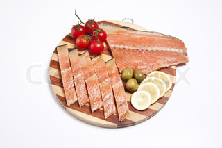 fresh red fish fillet on wooden plate