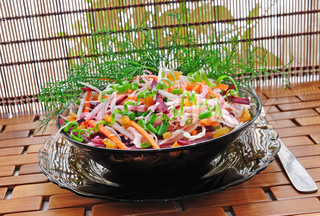 Cabbage salad with beets, carrots, raisins and herbs