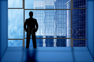silhouette businessman look office window on business buildings