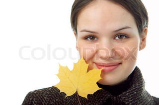 woman with autumn leaf on white background