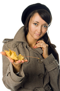 in outer clothing with autumn leaf over white background
