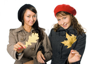 beauty girl friend in outer clothing with autumn leaf over white background