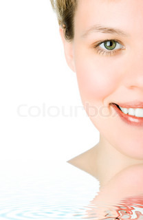 close-ups Half face girl looks in staff and widely smiles a white teeth
