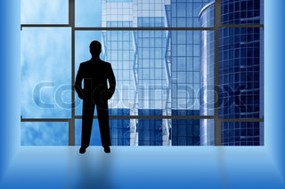 black silhouette man in office look window on business buildings
