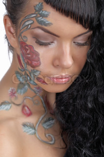 beauty woman with bodyart on face