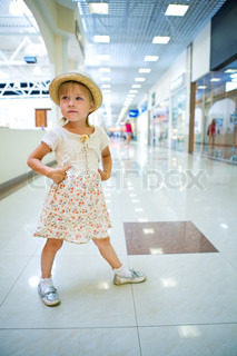 young little girl in shopping mall center