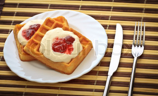 fork, knife and dish with soft waffles