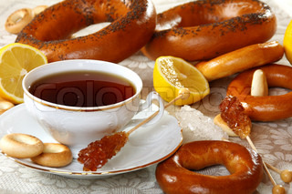 Tea with lemon and bagels on a linen napkin