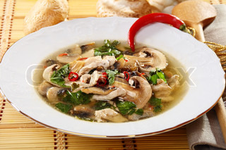 Spicy chicken soup with mushrooms and red pepper