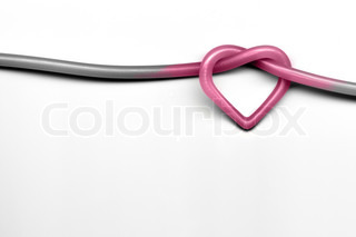pink heart knot on white background - valentine day concept