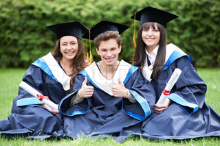 group of three graduate students sitting in the park cheerful and happy