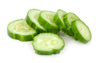 The cut cucumber is isolated on a white background