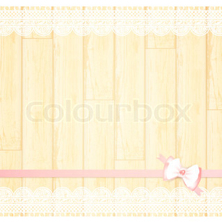 lace frame with pink bow at light wooden background