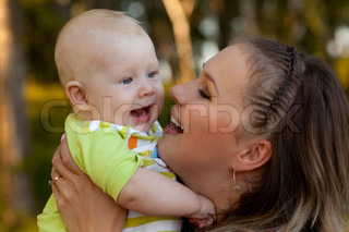 Mum and laughing kid on the nature
