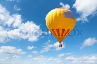 orange ballon on sky background, selective focus