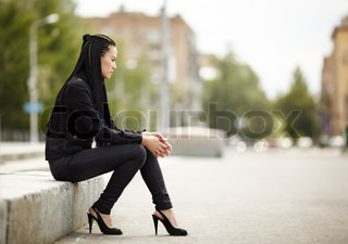 asian woman with black jeans, natural light, selective focus on face