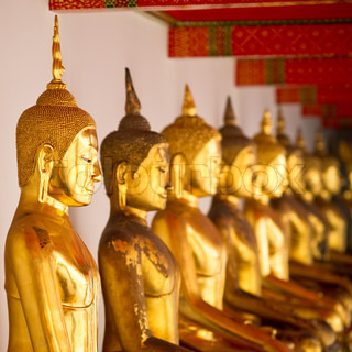 Statues of golden Buddha in Wat Pho, Bangkok, Thailand