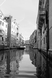 Classic view of Venice with canal and old buildings, Italy, black-white