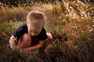 A young blond child in the nature