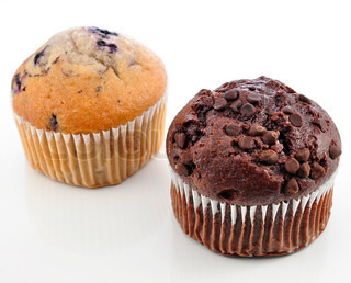 Chocolate and blueberry muffins on white background | Stock Photo ...