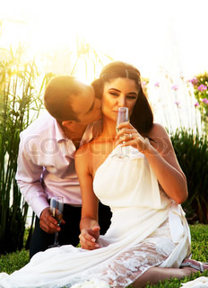 Happy young couple kissing outdoors, wedding day