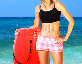 Beautiful sporty female holding body board, outdoor fun on the beach , water sport, healthy lifestyle concept