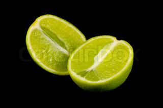 Lime fruits isolated against a black background