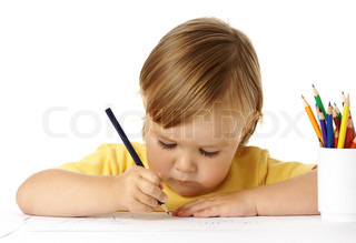 Cute child focused on his drawing, isolated over white