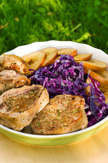 Pork medallions with sliced apples and red cabbage