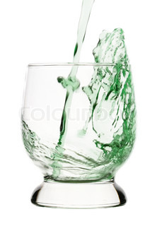Splash, green drink is being poured into glass, isolated over white