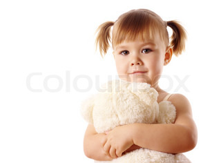 Cute little girl embracing her teddy bear toy, isolated over white