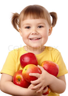 Cute child holds a lot of red apples, isolated over white