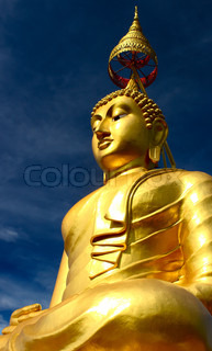 Statue of gold big buddha on dark blue sky backround