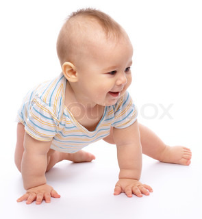 Happy child is crawling on floor and smile, isolated over white