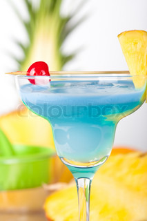 Blue alcohol cocktail with pineapple orange and cherry for Orange and blue cocktails