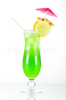 Green tropical cocktail with pineapple slice on white background