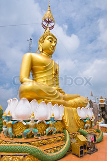 Big statue of Golden Buddha in Tiger temple, Krabi province, Thailand