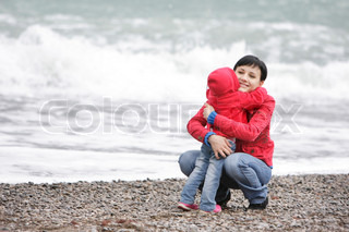 loving mother and child on beach