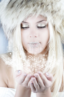 studio shot of winter girl with snowflakes in her hands
