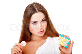 Pretty girl with condom and contraceptive pills Isolated over a white background